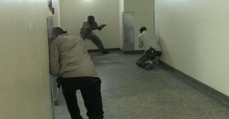 Image from AFPTV shows Kenyan security forces inside a shopping mall following an attack in Nairobi, September 21, 2013.  By Nichole Sobecki (AFPTV)
