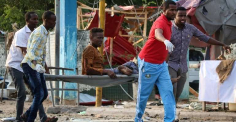 Friday's attack was the latest in a wave of bombings by Al-Shabaab, an Al-Qaeda affiliate which has been fighting to overthrow the internationally-backed Somali government for over a decade.  By ABDIRAZAK HUSSEIN FARAH (AFP)