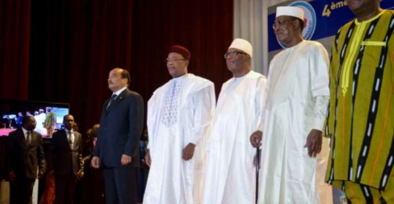 (From Left to Right) Mauritania's President Mohamed Ould Abdel Aziz, Niger's President Mahamadou Issoufou, Mali's President Ibrahim Boubacar Keita, Chad's President Idriss Deby and Burkina Faso's President Roch Marc Christian Kabore attended the G5 Sahel summit in Niamey, Niger.  By BOUREIMA HAMA (AFP/File)