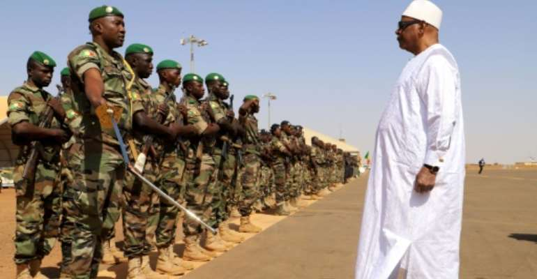 Front line: President Ibrahim Boubacar Keita inspects troops on a visit earlier this month to Gao, in Mali's volatile central region.  By Souleymane Ag Anara (AFP)
