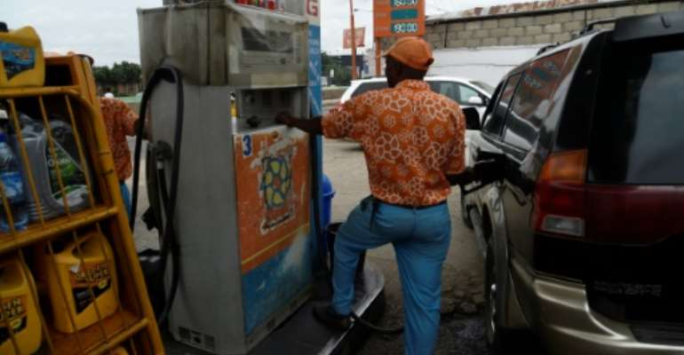 Fuel shock: The price of petrol in Nigeria has risen by around 15 percent after the government curbed subsidies.  By PIUS UTOMI EKPEI (AFP)