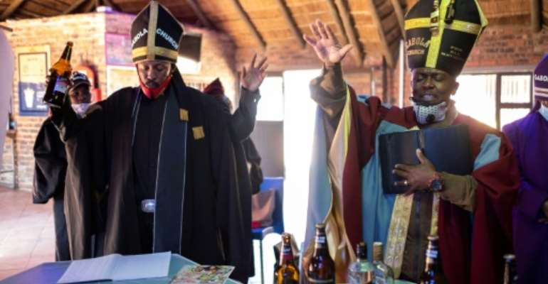 Gabola Church was founded three years ago by Tsietsi Makiti, right, to embrace people who would ordinarily be rejected by conventional churches that frown on imbibers.  By WIKUS DE WET (AFP)