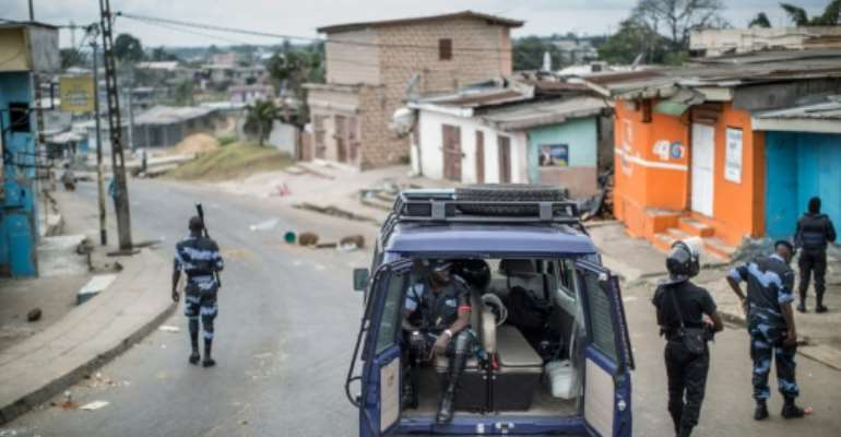 Gabonese police officers patrol near a barricade in the streets of Libreville on September 2, 2016.  By Marco Longari (AFP/File)
