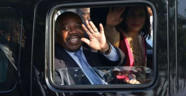 Gabonese President Ali Bongo Ondimba waves from his car upon returning to Libreville on Saturday after suffering a stroke and being treated in Morocco.  By Steve JORDAN (AFP)