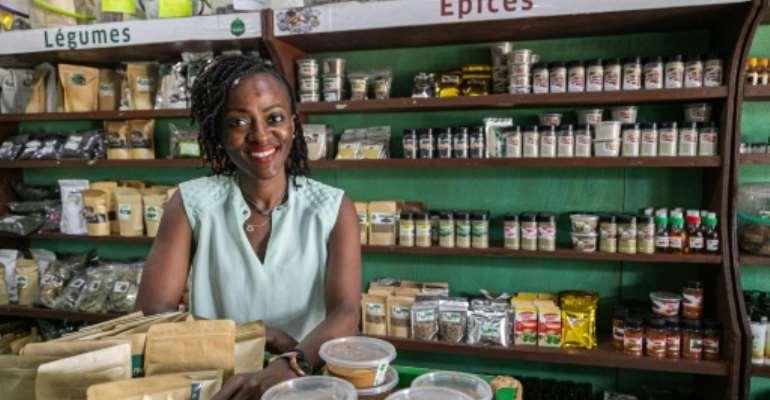 Gaelle Laura Zambou Kenfack poses at her Zenka Market Shop  in Yaounde.  By Daniel Beloumou Olomo (AFP)