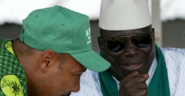 Gambia's former president Yahya Jammeh (R) and ex-army captain Edward Singhateh, both seen here in 2006, were close allies.  By SEYLLOU DIALLO (AFP)