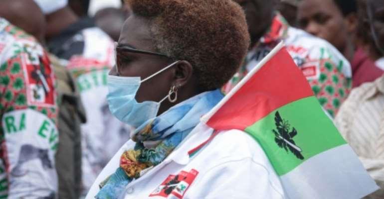 Gathering: A supporter of the ruling CNDD-FDD party attends a rally on April 27 to launch the campaign for Burundi's presidential elections.  By Tchandrou Nitanga (AFP)