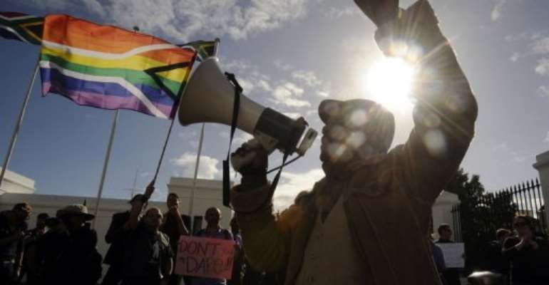 A group of people from the gay, lesbian and transgender community demonstrate in Cape Town in May 2012.  By Rodger Bosch (AFP/File)
