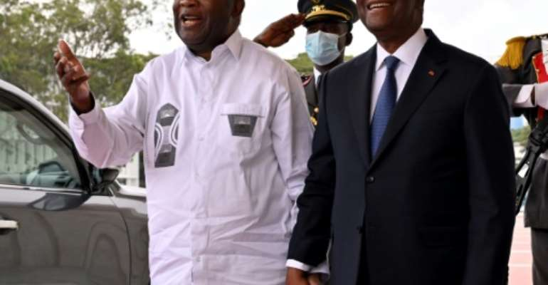 Gbagbo, left, with Ouattara last week. 'He will do all he can to free them as soon as possible,' Gbagbo said Monday.  By Issouf SANOGO (AFP/File)