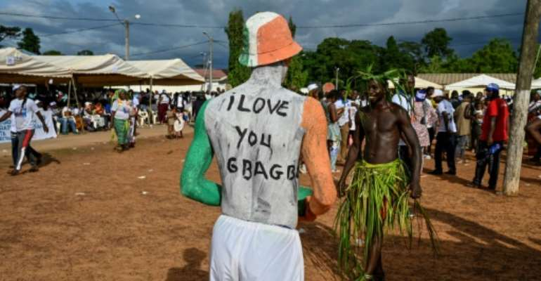 Gbagbo supporters gathered for his long-awaited return to his home village of Mama on June 27.  By SIA KAMBOU (AFP)