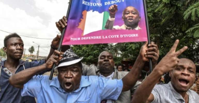 Gbagbo supporters in Abidjan celebrate his acquittal by the ICC in January 2019.  By ISSOUF SANOGO (AFP)