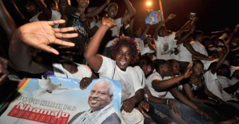 Guinea Bissau's Manuel Serifo Nhamadjo's supporters cheer during a rally in March 2012.  By Issouf Sanogo (AFP/File)
