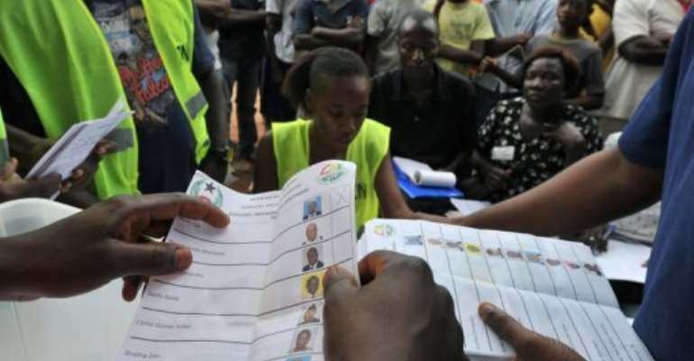 Electoral offciers count ballot papers at a polling station  in Bissau.  By Issouf Sanogo (AFP)