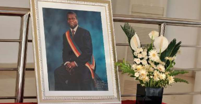 A portrait of slain Guinea-Bissau president Joao Bernardo Vieira stands on a table during his funeral at the National Assembly in Bissau on March 10, 2009.  By Seyllou Diallo (AFP/File)
