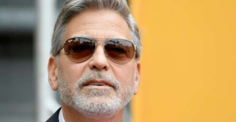 George Clooney, seen here in May 2019, is calling for financial pressure on Sudan's generals.  By Tiziana FABI (AFP/File)