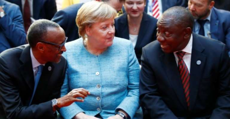 German Chancellor Angela Merkel with Rwanda President Paul Kagame (left) and South African President Cyril Ramaphosa (right).  By AXEL SCHMIDT (POOL/AFP)