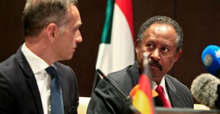 German Foreign Minister Heiko Maas (L) and Sudan's Prime Minister Abdallah Hamdok give a joint press conference in the Sudanese capital Khartoum on Tuesday.  By Ebrahim HAMID (AFP)