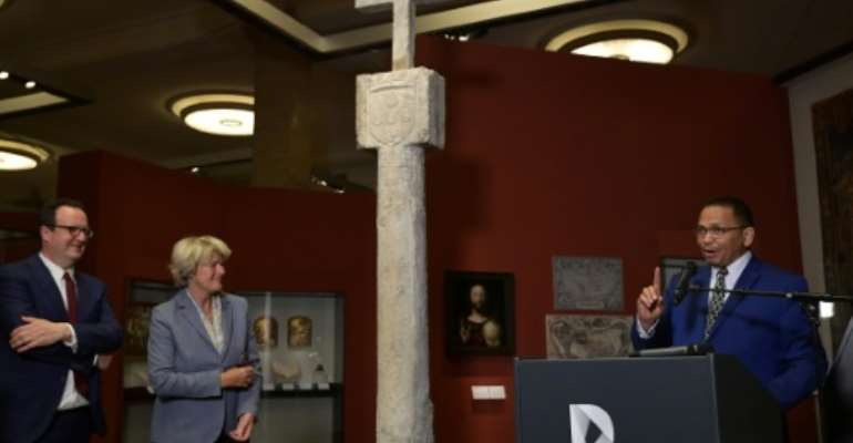 Germany is handing over a 15th century navigation cross to Namibia, part of efforts to return colonial heritage.  By Tobias SCHWARZ (AFP)