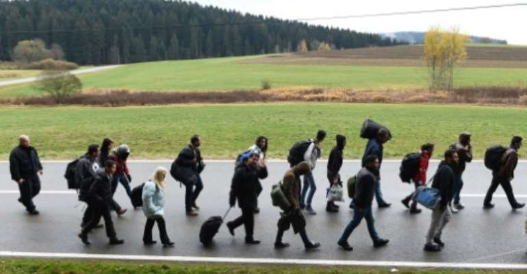 Migrants on the road after crossing the Austrian-German border near the Bavarian village of Wegscheid, southern Germany on November 9, 2015.  By Christof Stache (AFP/File)
