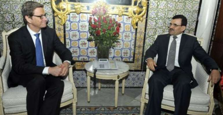 Tunisian PM Ali Larayedh (R) meets with Germany's Foreign Affairs Minister Guido Westerwelle on March 19, 2013, in Tunis.  By Fethi Belaid (AFP)