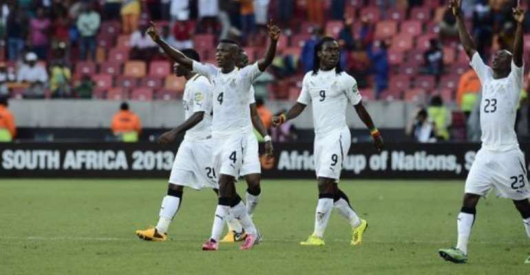 Ghana players celebrate their win in the African Cup of Nations quarter final against Cape Verde, on February 2, 2013.  By Stephane de Sakutin (AFP)