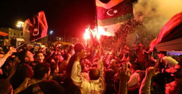 Libyan football fans celebrate in Martyrs' Square in the Libyan capital Tripoli on January 29, 2014 after the national team defeated Zimbabwe in its African Nations Championship semi-final match.  By  (AFP)