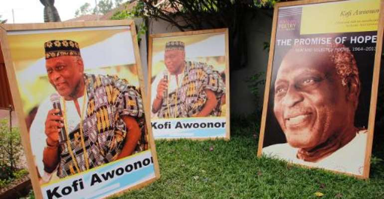 Pictures of Ghanaian poet and statesman Kofi Awoonor are displayed outside his house in Accra on September 30, 2013.  By Chris Stein (AFP/File)