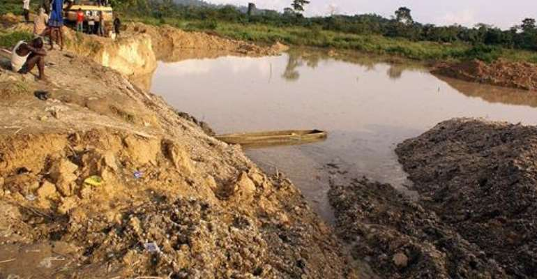 Human Rights Watch claims that gold used in jewellery and electronics may have been sourced from illegal mines similar to this one that collapsed at Dunkwa on-Offin, Ghana on June 27, 2010.  By Adadevoh David (AFP/File)