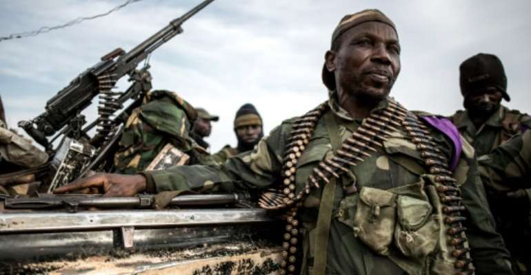 Government troops at a base in Djugu, eastern DR Congo -- the springboard for a weeks-long operation against militia in Wago Forest.  By John WESSELS (AFP)