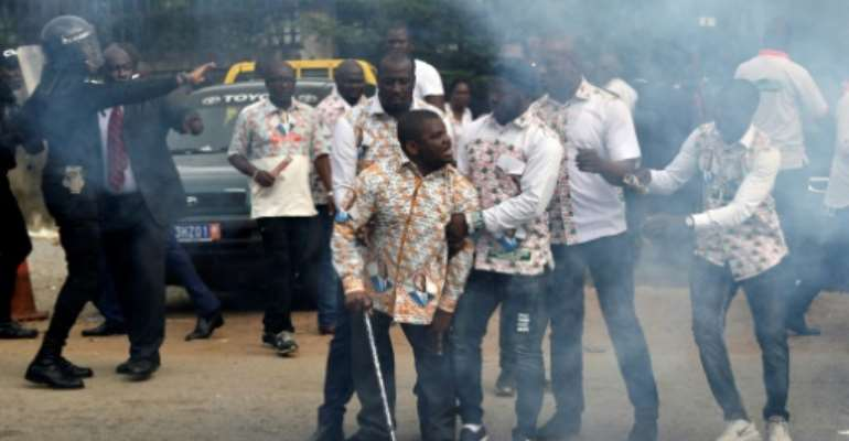 GPS members clashed with police outside party headquarters on Monday.  By SIA KAMBOU (AFP)
