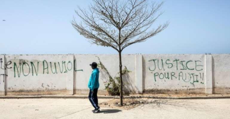 Grafitti in Senegal's Dakar reads