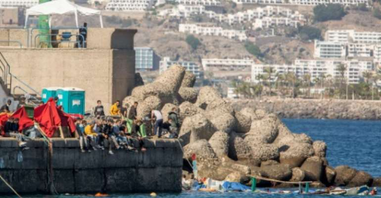 Gran Canaria's Arguineguin port has been overwhelmed with migrant arrivals.  By DESIREE MARTIN (AFP)