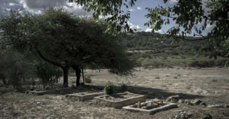 Graves are seen at a monument built for the victims of the campaign, unleashed by an elite North Korean-trained military unit shortly after Zimbabwean independent and known infamously as Gukurahundi.  By ZINYANGE AUNTONY (AFP/File)