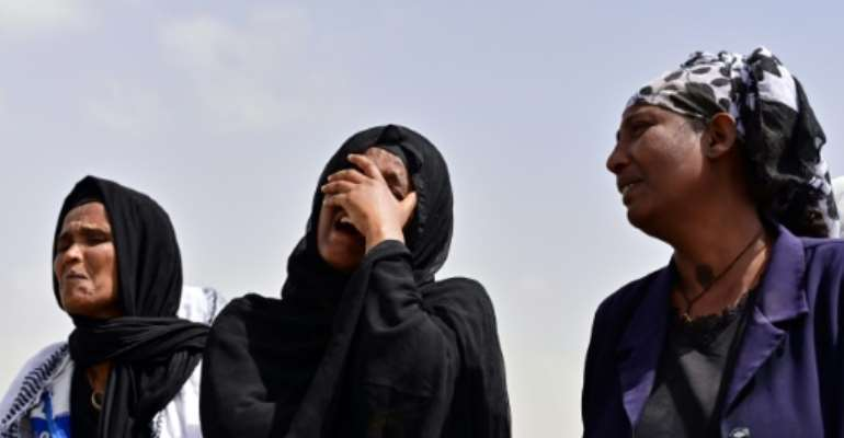Grief: Relatives arrive at the site.  By TONY KARUMBA (AFP)