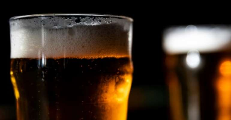 Grin and beer it: Clandestine bars are doing good business in lockdown Libreville.  By KENZO TRIBOUILLARD (AFP/File)