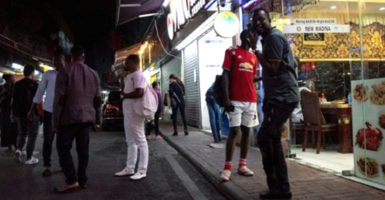 Guangzhou in southern China is home to a sizeable African community (pictured March 2018).  By FRED DUFOUR (AFP/File)