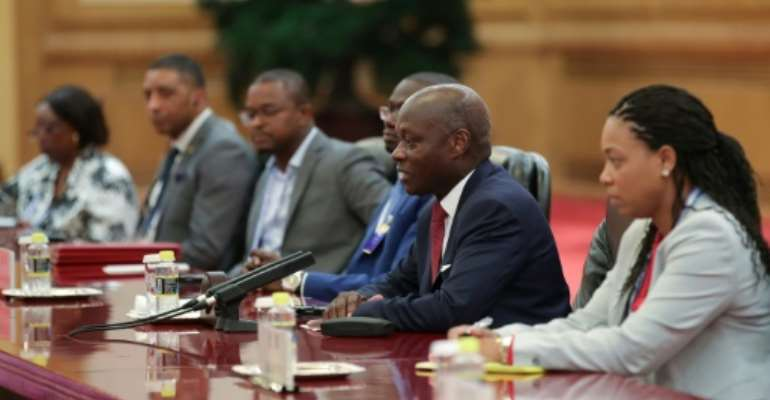 Guinea Bissau President Jose Mario Vaz (2nd R, pictured September 2018) rejected the PAIGC party's repeated proposal of former premier Domingos Simoes Pereira.  By Lintao Zhang (POOL/AFP/File)