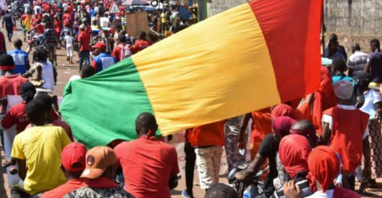 Guinea has been hit by protests against President Alpha Conde since October.  By CELLOU BINANI (AFP/File)