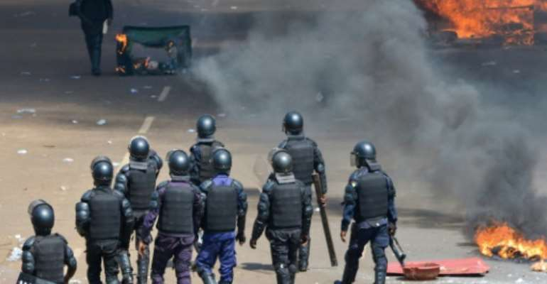 Guinea has been shaken by violence during weeks of demonstrations over opposition suspicions that President Alpha Conde is seeking a third term in office.  By CELLOU BINANI (AFP)