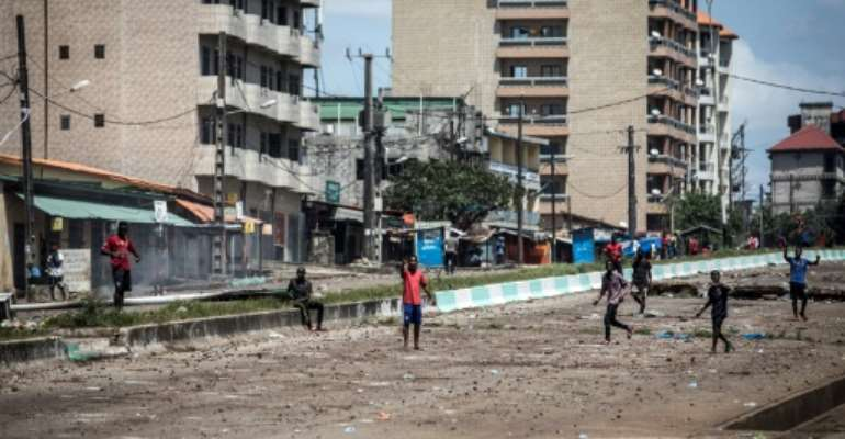 Guinea mobilised the army as clashes broke out in the capital Conakry and other cities.  By JOHN WESSELS (AFP)