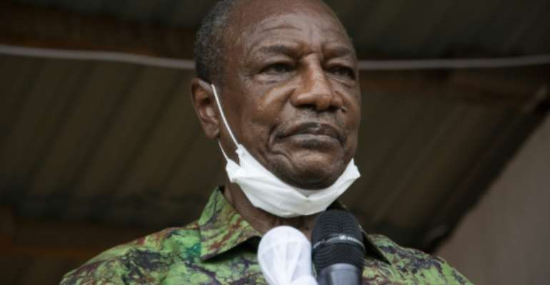 Guinea President Alpha Conde says his third term will be different from the two previous ones.  By CAROL VALADE (AFP/File)