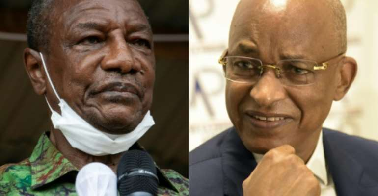 Guinea President Alpha Conde will seek to stave off a challenger from his old political opponent Cellou Dalein Diallo in Sunday's election.  By CAROL VALADE, Seyllou (AFP/File)