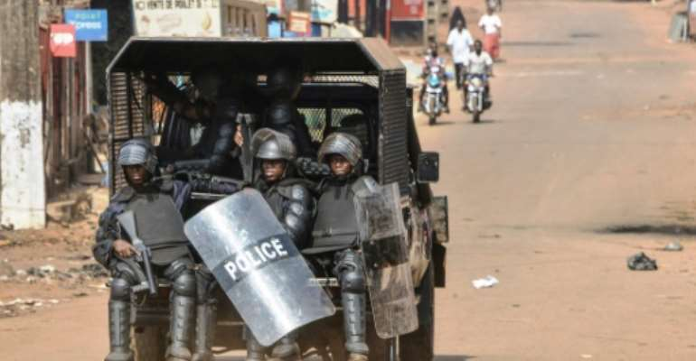Guinean police have been clashing with anti-government protesters.  By CELLOU BINANI (AFP)