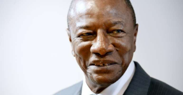 Guinean President Alpha Conde, pictured on June 7, 2017, has offered to work with Qatar and other Gulf countries in order to reach a compromise for the ongoing Gulf crisis.  By THIERRY CHARLIER (AFP/File)