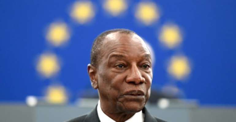 Guinean President Alpha Conde, seen here in May 2018, is facing calls not to amend the constitution to allow himself a new term.  By FREDERICK FLORIN (AFP/File)
