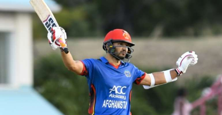Gulbadin Naib of Afghanistan celebrates his half century during the second ODI against the West Indies at Darren Sammy National Cricket Stadium in Gros Islet, St. Lucia, June 11, 2017.  By Randy BROOKS (AFP/File)