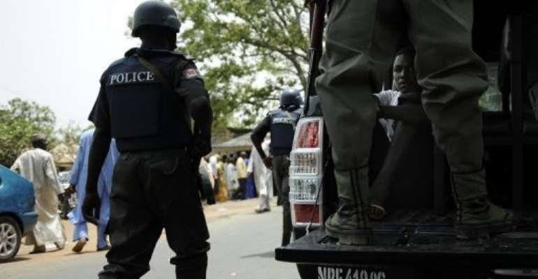 Nigerian police detain suspects on April 28, 2011 in Bauchi state, northern Nigeria.  By Tony Karumba (AFP/File)