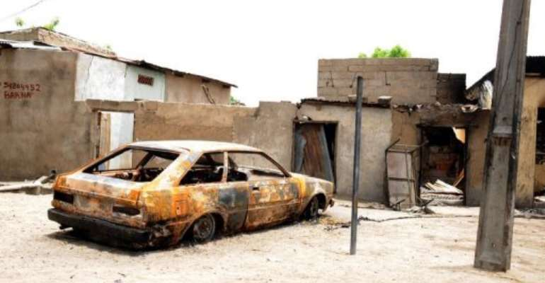 A house and car are ravaged by a bomb explosion by the Islamist group Boko Haram in Maiduguri, Nigeria, in May 2012.  By Pius Utomi Ekpei (AFP/File)