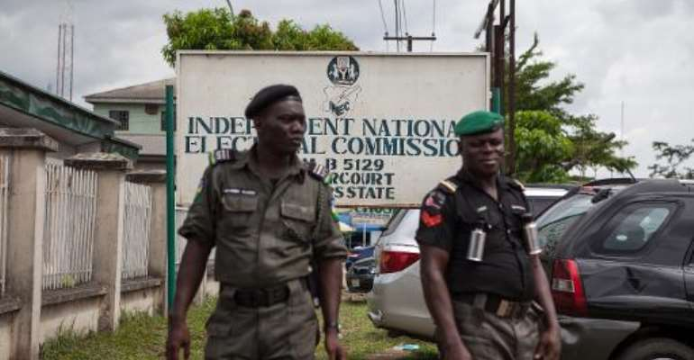 Nigerian police stand guard outside the Independent National Electoral Commission (INEC) offices in Port Harcourt, on March 26, 2015.  By Florian Plaucheur (AFP/File)
