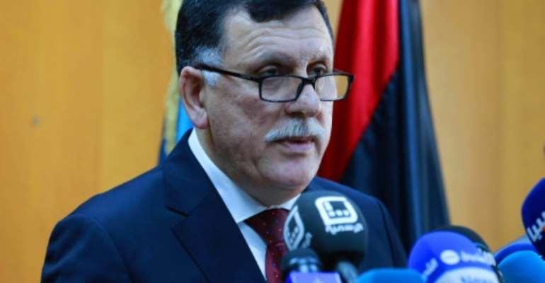 Libya's UN-backed Prime Minister-designate, Fayez al-Sarraj speaks on March 30, 2016 in the capital Tripoli.  By  (AFP)